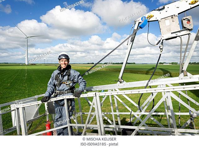 Maintenance worker before starting work on the blades of a wind turbine