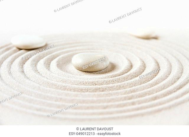 White stones in the sand. Zen japanese garden background scene