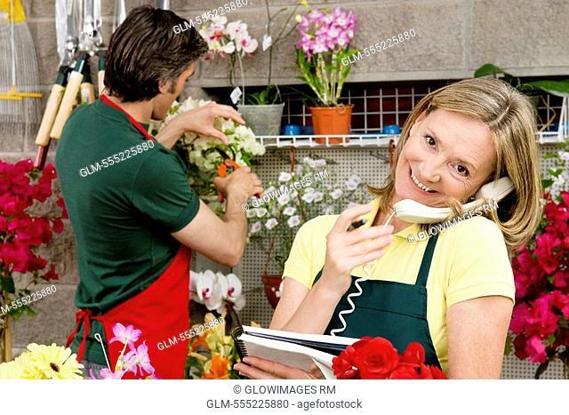 Female florist talking on the phone