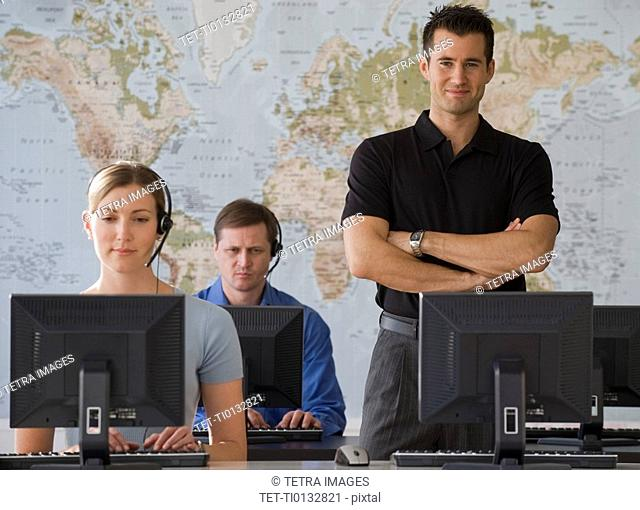 Call center employees with map in background