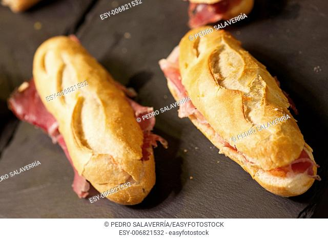 forefront of a group of Iberian ham sandwiches