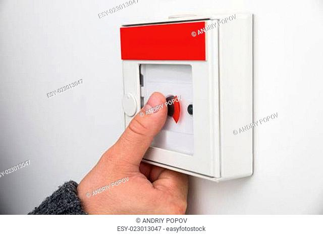 Man Pressing Emergency Button