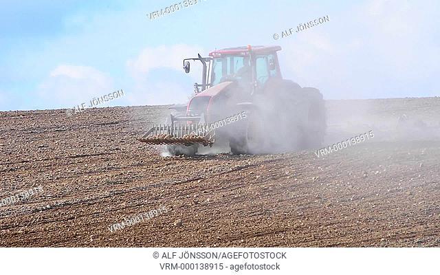 Tractor in dusty work