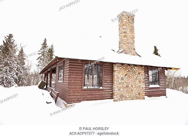 Log Cabin covered in snow in Elk Island National Park, Alberta, Canada