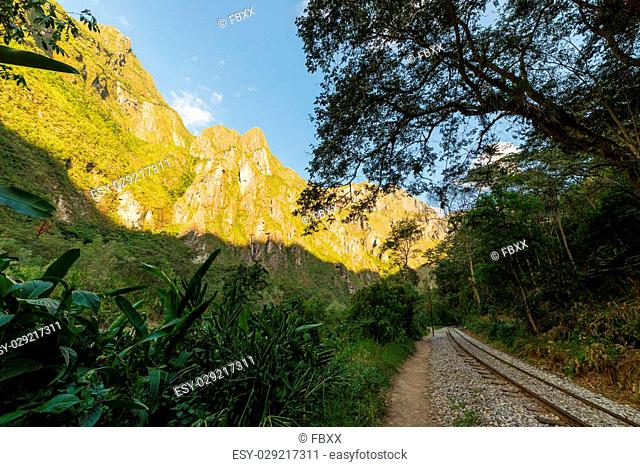 The railroad track crossing jungle and Urubamba river, connecting Machu Picchu village to hydroelectric station, mostly used for tourism and cargo purpose