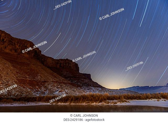 Star trails over Colorado Riverway Recreation Area near Moab; Utah, United States of America
