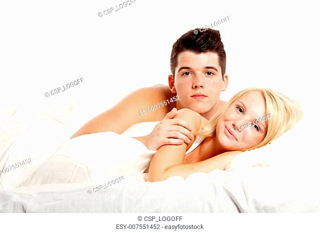 Loving affectionate heterosexual couple on bed