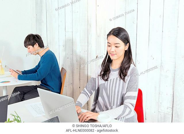 Young co-workers working in a stylish office