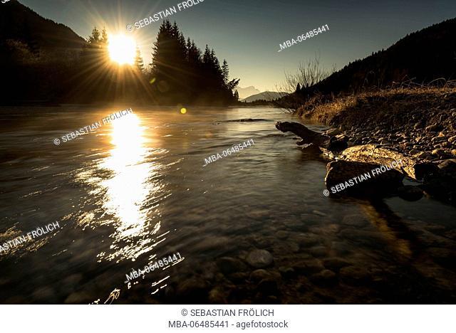 Sunrays on the Isar river near Wallgau