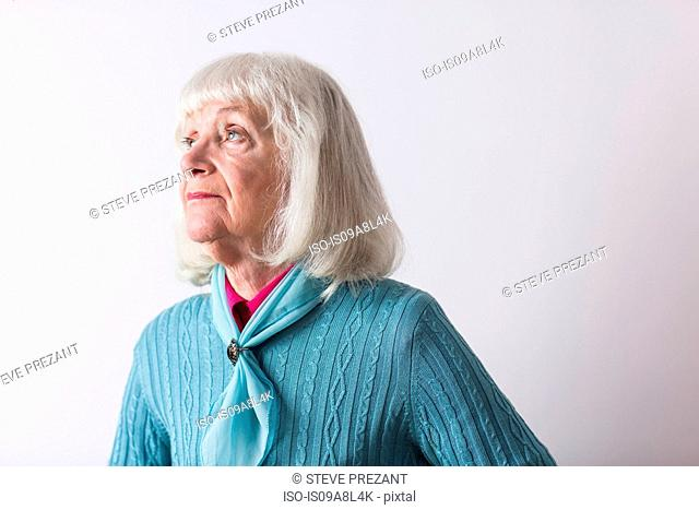 Senior woman with grey hair looking away