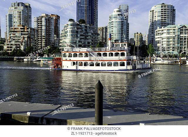 Old paddle wheeler boat cruising the false creek harbour in Vancouver B C