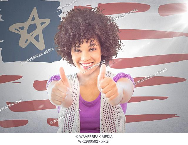 Woman giving two thumbs up against hand drawn american flag and white wall with flare