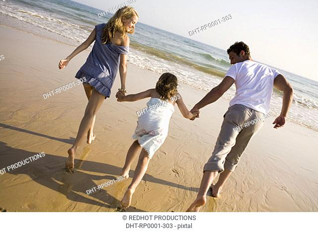 Family on beach playing together