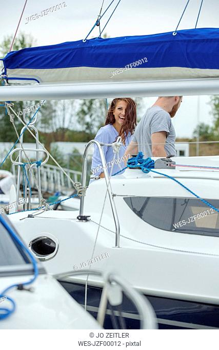 Happy couple on a sailing boat