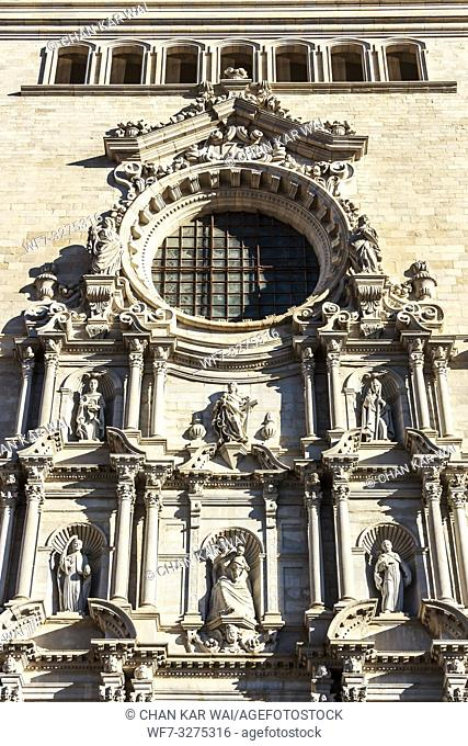 Girona, Spain - Dec 2018: Sculptures of the main facade of Girona Cathedral. The facade work was completed in 1961