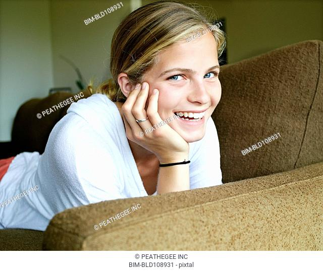 Caucasian girl laying on sofa
