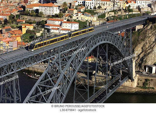 Porto Metro crossing Dom Luis I Bridge seen from Jardim do Morro, Porto, Portugal
