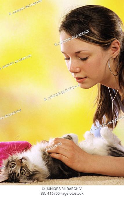 young woman fondling kitten