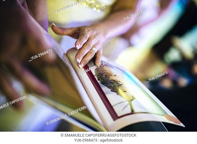 hands browse photo book
