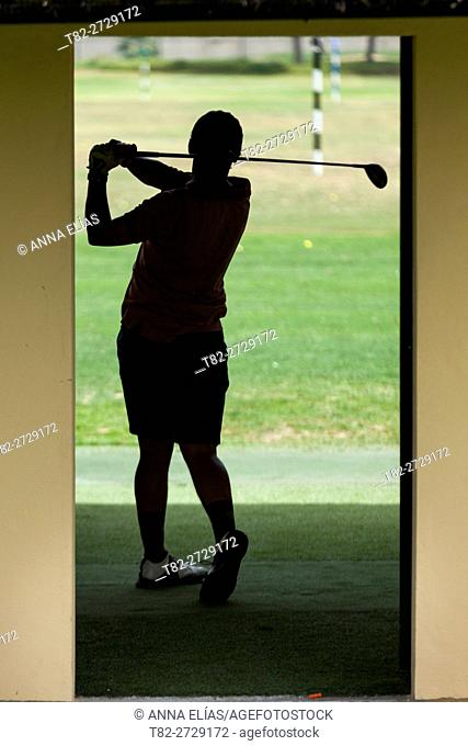 silhouette Man throwing balls on the golf course, Sevilla, Andalucia, Spain, Europe