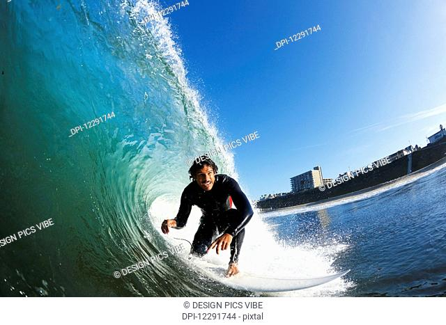 Surfer on Blue Ocean Wave, View from in the Water