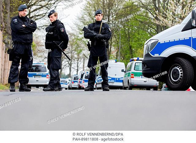 Police officers stand outside the l'Arrivée hotel in Dortmund, Germany, 12 April 2017. Three explosions occurred next to the team bus of the Borussia Dortmund...