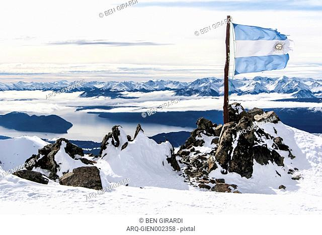 The Ripped And Torn Argentina Flag On The Top Of Cerro Catedral Resort