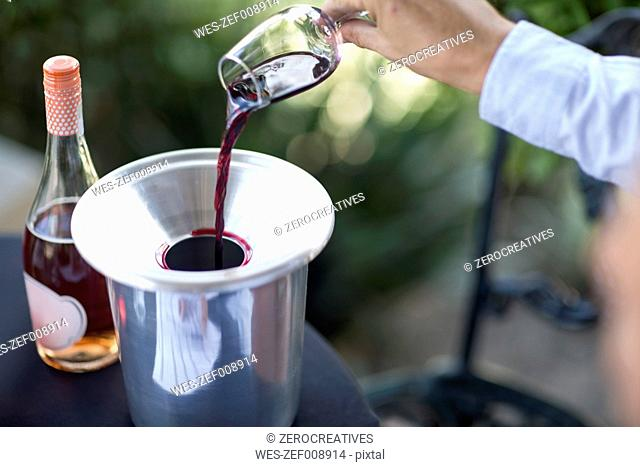 Man pouring out glass of red wine
