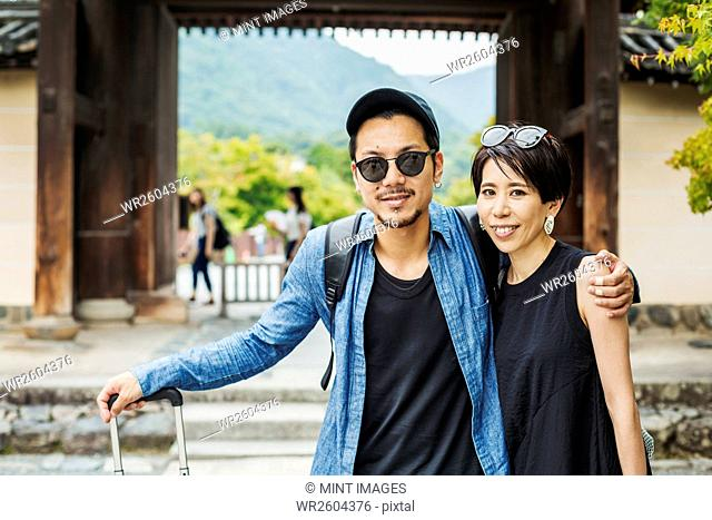 A man and woman visiting a historic temple in Japan