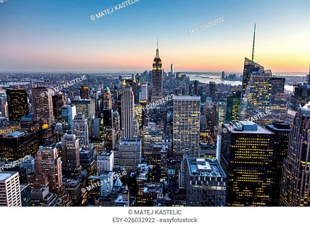New York City. Manhattan downtown skyline with illuminated Empire State Building and skyscrapers at dusk