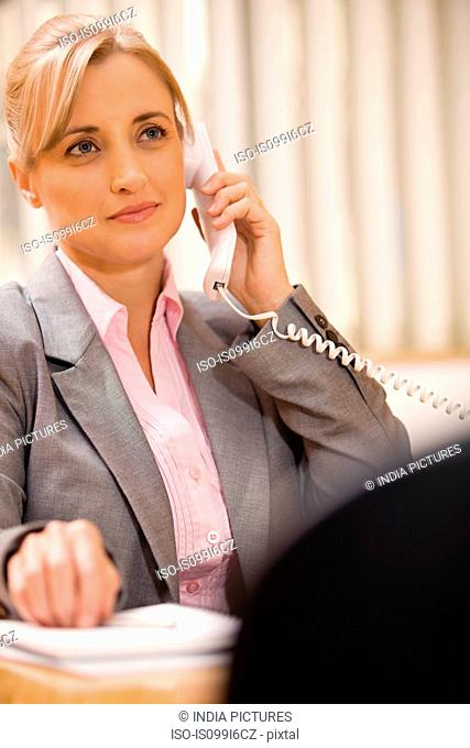 Female executive talking on the phone