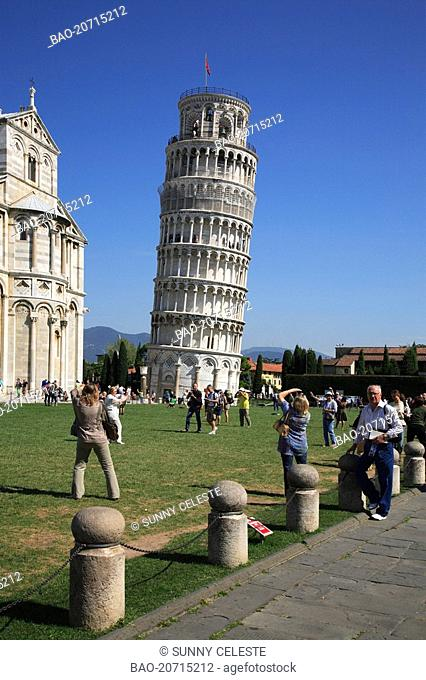 tourist taking pictures at the leaning tower at Pisa, Tuscany, Italy