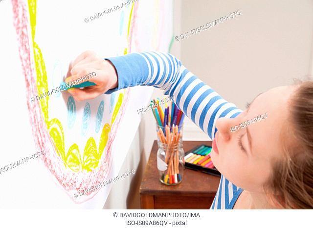 Girl drawing on wall