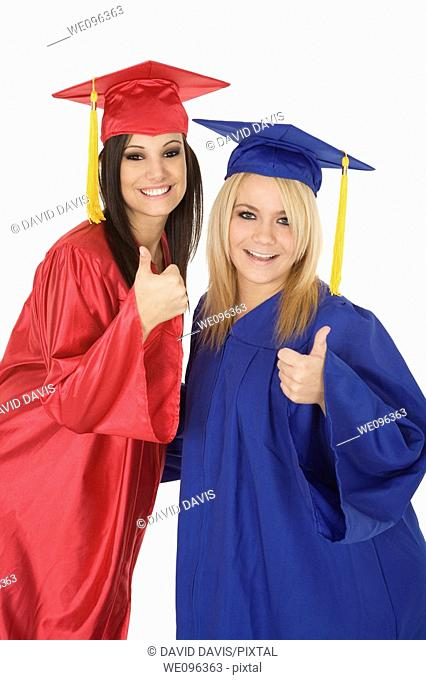Beautiful Caucasain girls in gratuation gowns and smiling