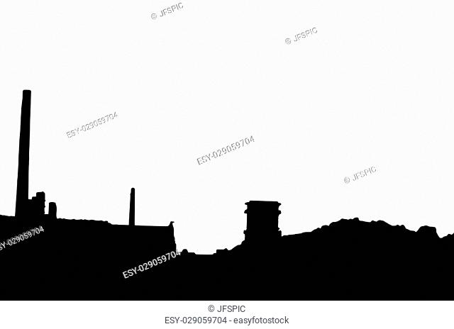 Silhouette of an old factory building with chimneys against white background