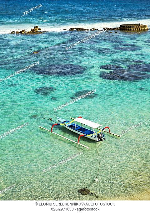 Indonesian outrigger canoe, also known as jukung or cadik moored in Mendira Bay. Candidasa, Manggis subdistrict, Karangasem regency, Bali, Indonesia