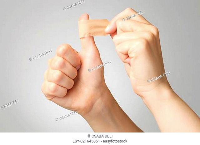 Woman with a plaster on her thumb