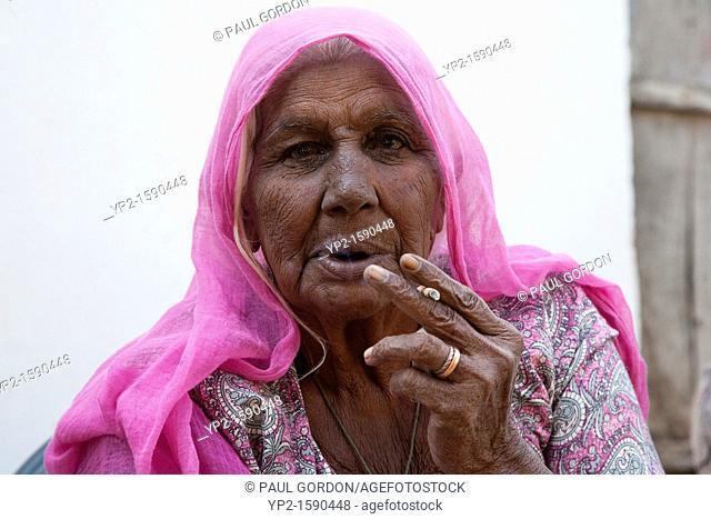 Mature woman smoking - Shyampura Village, Rajasthan, India