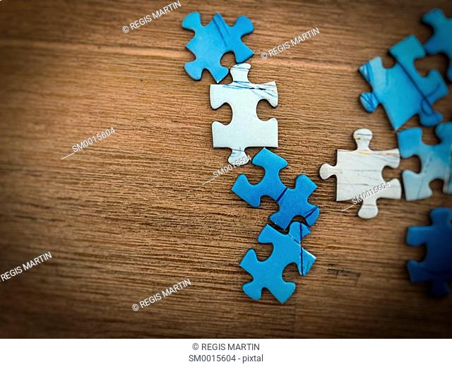 puzzle pieces view from above on a wooden table with a vignette effect