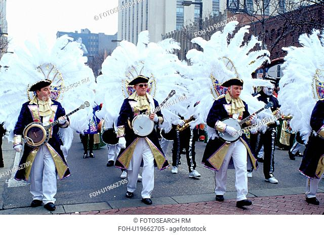 parade, costume, band, Philadelphia, PA, Pennsylvania, Members of a String Band dressed in costumes play their banjos and strut in the Mummers Day Parade on New...