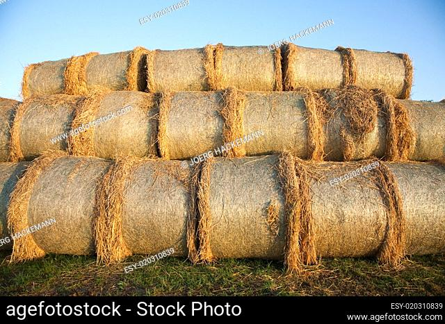 bale of straw with blue sky