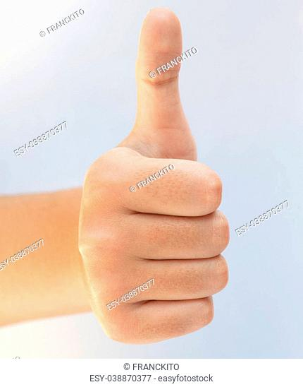 Female hand with thumb up in a white background