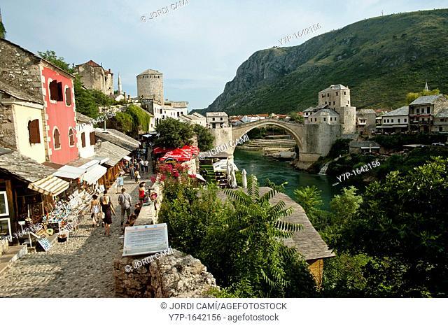 Cobbled street and the Stari Most Peace Bridge on the Neretva river Mostar Bosnia- Herzegovina Balkans Europe