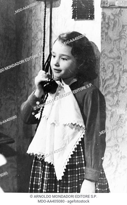 Raffaella Carrà on the phone in Torment of the past. Italian TV host, actress, singer and showgirl Raffaella Carrà (Raffaella Maria Roberta Pelloni) speaking...