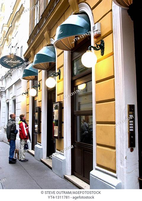 A couple looking at the menu  Figmueller restaurant, Vienna, Austria