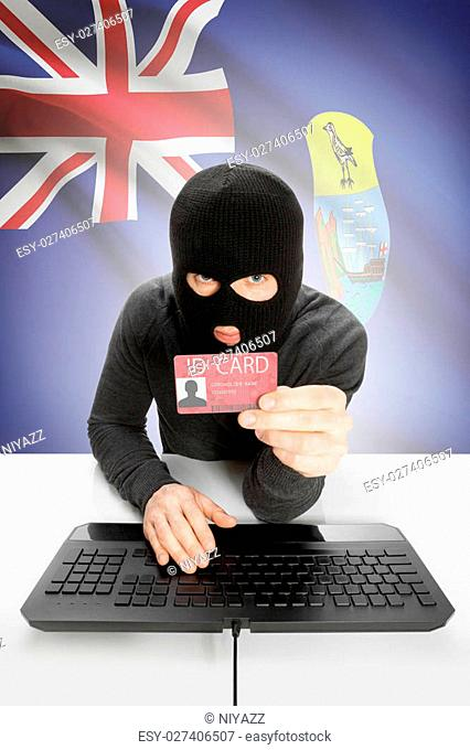 Hacker with ID card in hand and flag on background - Saint Helena