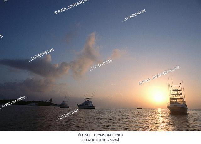 Silhouette of Deepsea Fishing Boats at sunset  Malindi District, Kenya
