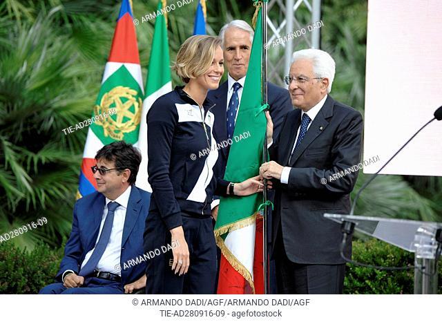 The athlete Federica Pellegrini returns the Italian flag to Republic President Sergio Mattarella during the ceremony at Quirinale, Rome, ITALY-28-09-2016