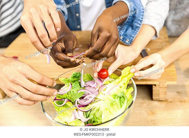 Friends preparing salad