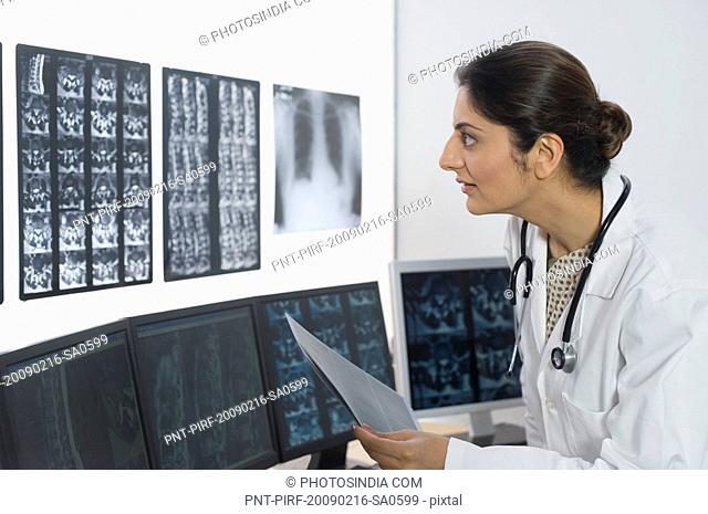 Female doctor examining X-Ray report
